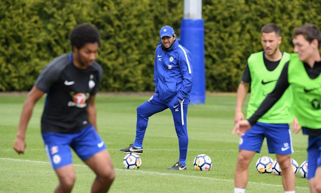 Antonio Conte watches training in preparation for Chelsea's trip to Newcastle.