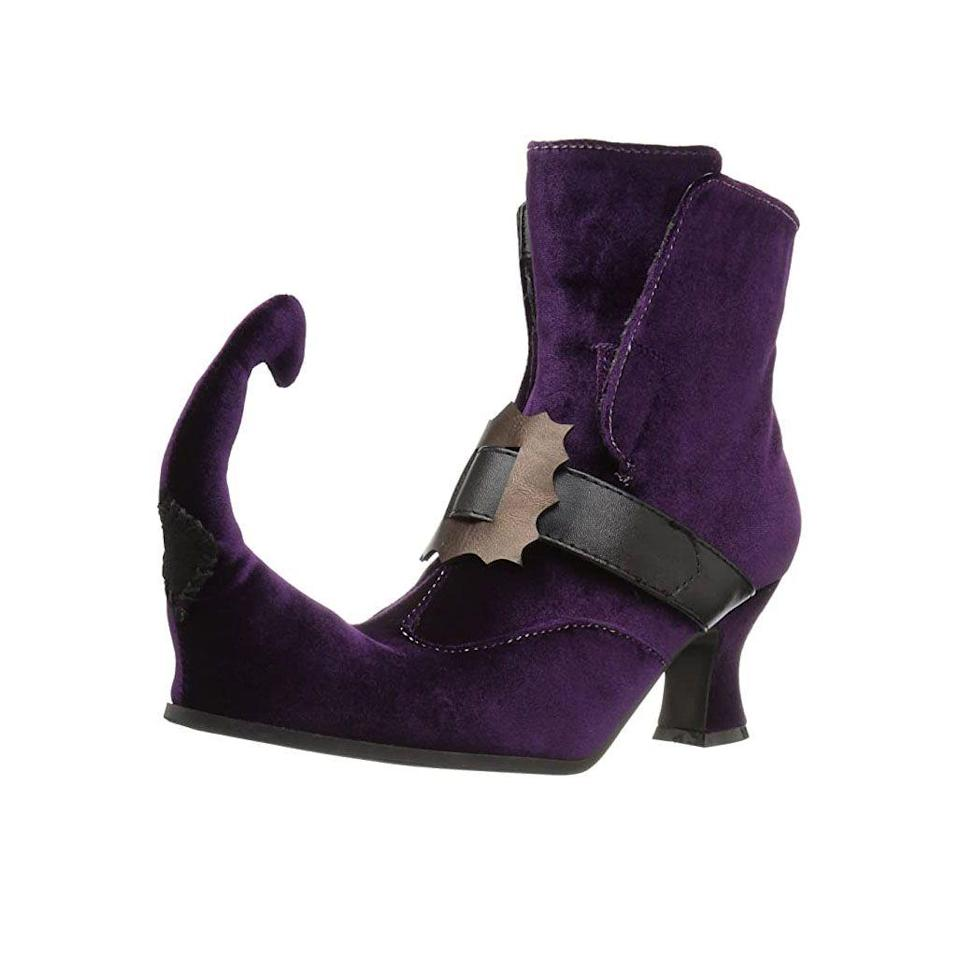 """<p><strong>Ellie Shoes</strong></p><p>amazon.com</p><p><strong>$46.24</strong></p><p><a href=""""https://www.amazon.com/dp/B01J7NIDYU?tag=syn-yahoo-20&ascsubtag=%5Bartid%7C10050.g.4786%5Bsrc%7Cyahoo-us"""" rel=""""nofollow noopener"""" target=""""_blank"""" data-ylk=""""slk:Shop Now"""" class=""""link rapid-noclick-resp"""">Shop Now</a></p><p>Or go all out with a pair of these purple suede witch boots that are sure to win lots of compliments!</p>"""