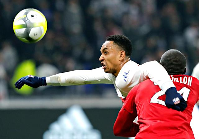 <p>Lyon's Kenny Tete, left, challenges for the ball with Montpellier's Jerome Roussillon, right, during their French League One soccer match in Decines, near Lyon, central France, Sunday, Nov. 19, 2017. (AP Photo/Laurent Cipriani) </p>