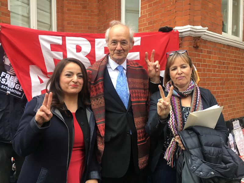 Julian Assange's father John Shipton, poses with German MPs Sevim Dagdelen and Heike Hansel, outside the Ecuadorian embassy in London, Britain, December 20, 2018. REUTERS/Will Russell