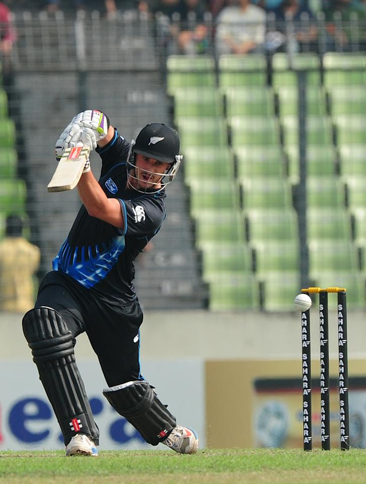 New Zealand batsman Hamish Rutherford plays a shot during the T20 match between Bangladesh and Zew Zealand at the Sher-e-Bangla National Cricket Stadium in Dhaka on November 6, 2013.  AFP PHOTO/ Munir uz ZAMAN        (Photo credit should read MUNIR UZ ZAMAN/AFP/Getty Images)