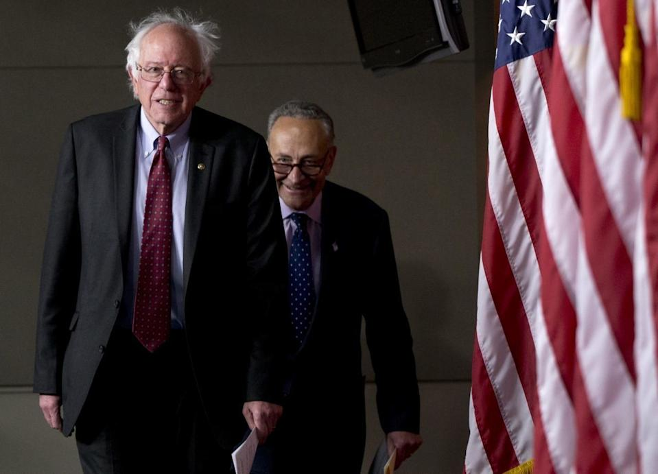 Sen. Bernie Sanders, I-Vt., left, followed by Sen. Charles Schumer, D-N.Y., arrives for a news conference on Capitol Hill in Washington, Wednesday, April 29, 2015. (AP Photo/Carolyn Kaster)