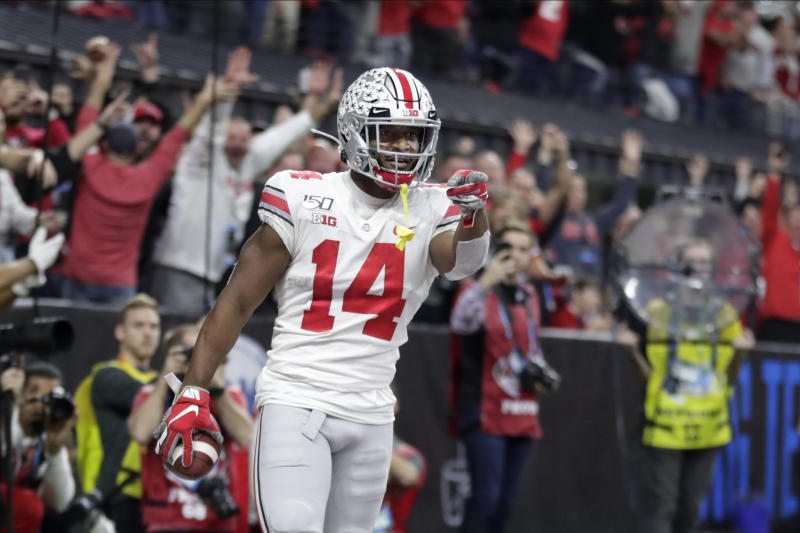 Ohio State wide receiver K.J. Hill (14) celebrates after making a touchdown catch during the second half of the team's Big Ten championship NCAA college football game against Wisconsin, Saturday, Dec. 7, 2019, in Indianapolis. (AP Photo/Michael Conroy)