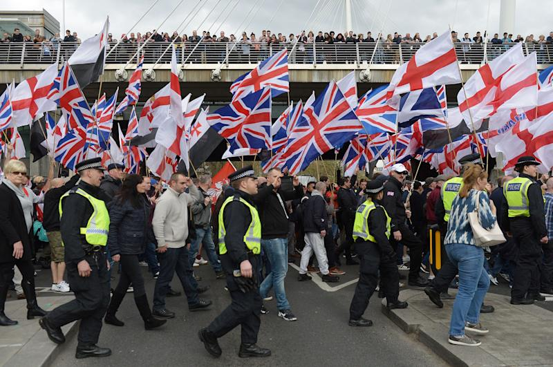 Britain First and EDL (English Defence League) protesters at a demonstration in London two years ago. Both groups have been banned from Facebook (Photo: PA Archive/PA Images)