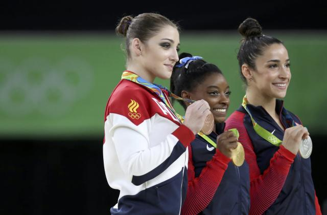 2016 Rio Olympics - Artistic Gymnastics - Final - Women's Individual All-Around Victory Ceremony - Rio Olympic Arena - Rio de Janeiro, Brazil - 11/08/2016. Simone Biles (USA) of the U.S., Alexandra Raisman (USA) of the U.S. and Aliya Mustafina (RUS) of Russia pose with their medals. REUTERS/Damir Sagolj FOR EDITORIAL USE ONLY. NOT FOR SALE FOR MARKETING OR ADVERTISING CAMPAIGNS.