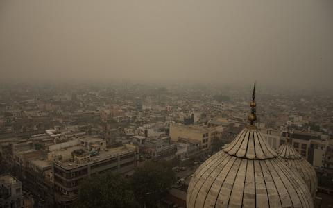 The toxic smog is visible on the old quarter of Delhi - Credit: Javed Sultan/Anadolu Agency via Getty Images