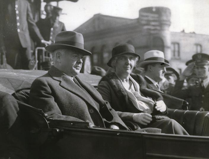 President Herbert Hoover in Madison in 1932. President and Mrs. Hoover shown in auto after their arrival.