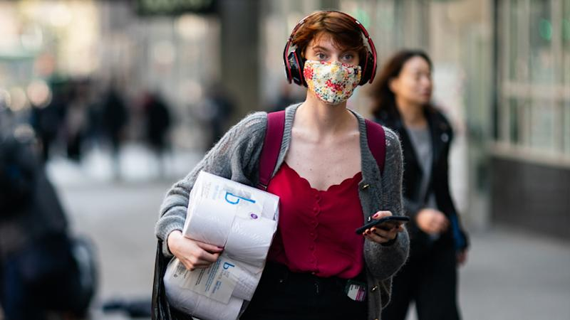 A woman shopping wearing a face mask to prevent the spread of coronavirus.