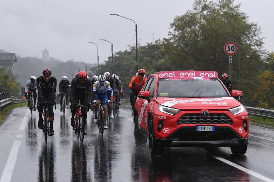 ASTI ITALY  OCTOBER 23 Filippo Ganna of Italy and Team INEOS Grenadiers  Davide Ballerini of Italy and Team Deceuninck  QuickStep  Josef Cerny of Czech Republic and CCC Team  Race neutralised due to heavy rain and team riders protest  during the 103rd Giro dItalia 2020 Stage 19 a 258km stage from Morbegno to Asti  girodiitalia  Giro  on October 23 2020 in Asti Italy Photo by Tim de WaeleGetty Images