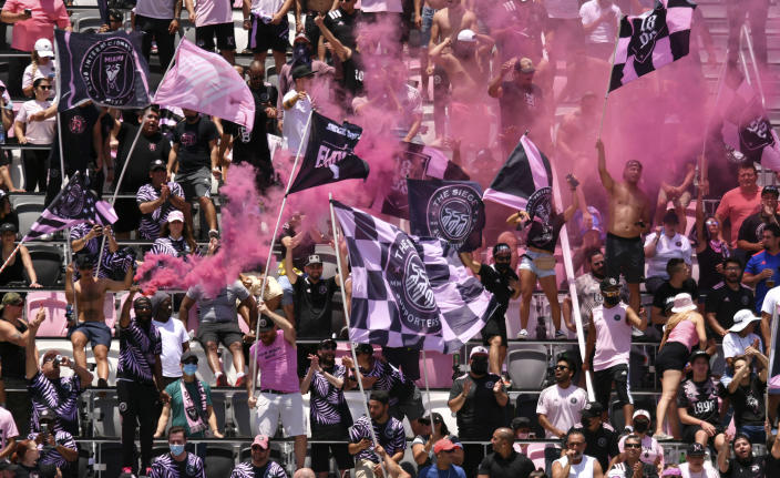 Inter Miami fans cheer on their team against Atlanta United during the first half of an MLS soccer match, Sunday, May 9, 2021, in Fort Lauderdale, Fla. (AP Photo/Jim Rassol)