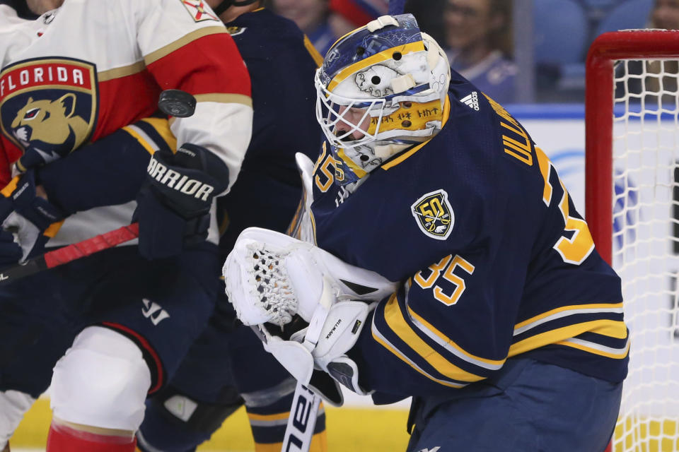 Buffalo Sabres goalie Linus Ullmark (35) stops the puck during the second period of an NHL hockey game against the Florida Panthers, Saturday, Jan. 4, 2020, in Buffalo, N.Y. (AP Photo/Jeffrey T. Barnes)