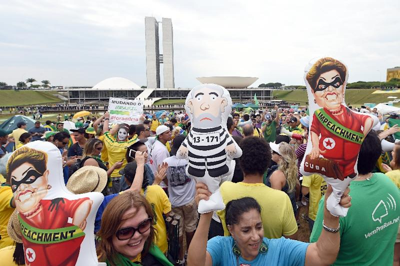Protesters with inflatable dolls of Brazilian President Dilma Rousseff and former president Lula da Silva demonstrate calling for her impeachment and blaming her for a steep economic downturn in Brazil, in Brasilia on November 15, 2015