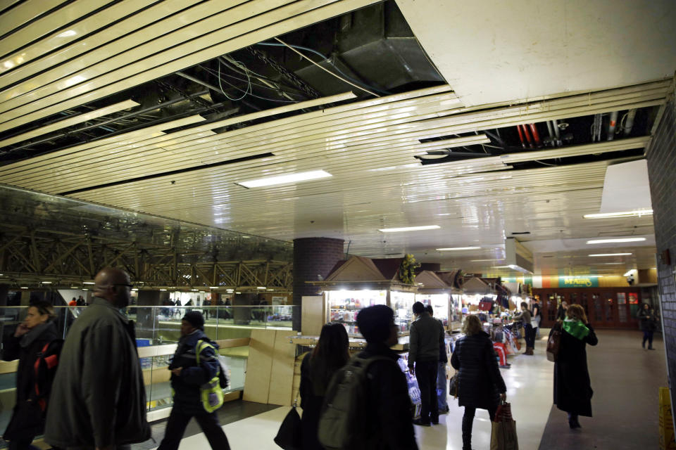 FILE — In this March 19, 2015 file photo, large panels of the ceiling are missing at the Port Authority Bus Terminal in New York. New York City's main bus terminal, long ridiculed for leaky ceilings, dirty bathrooms and frequent delays, could be in for a major overhaul. The Port Authority of New York and New Jersey unveiled a plan Thursday, Jan. 21, 2021, to rebuild and expand the embattled midtown Manhattan bus terminal. (AP Photo/Seth Wenig File)
