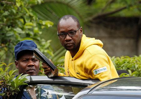 Activist Pastor Evan Mawarire is taken into a vehicle by police outside his home in Harare