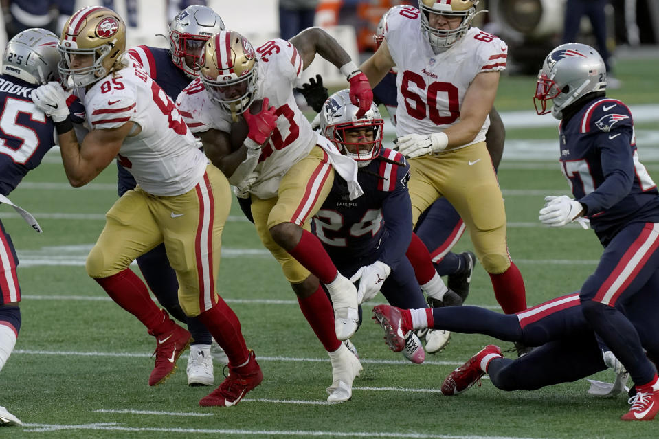 San Francisco 49ers running back Jeff Wilson Jr. (30) runs from New England Patriots cornerback Stephon Gilmore (24) in the first half of an NFL football game, Sunday, Oct. 25, 2020, in Foxborough, Mass. (AP Photo/Steven Senne)