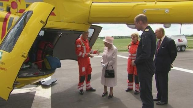 Prince William shows the Queen around as she opens a new Air Ambulance base in Cambridge. .