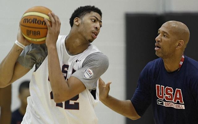 USA Basketball forward/center Anthony Davis of the New Orleans Jazz posts up against a coach during a team practice at the Brooklyn Nets training facility in East Rutherford, N.J.,Tuesday, Aug. 19, 2014. (AP Photo/Kathy Willens)