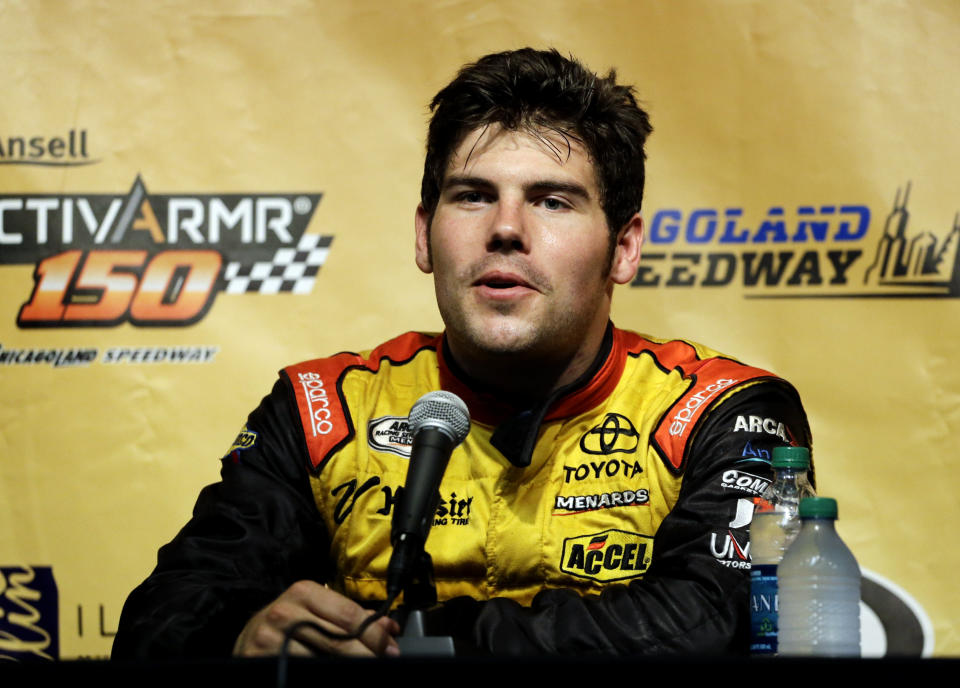 FILE - In this July 19, 2014, file photo, John Wes Townley speaks at a news conference after qualifying for the Arca Racing Series auto race at Chicagoland Speedway in Joliet, Ill. Former NASCAR driver Townley was killed Saturday, Oct. 2, 2021, in a shooting in Georgia that also wounded a woman, investigators said. Townley, 31, died in the shooting in a neighborhood around 9 p.m., Athens-Clarke County Coroner Sonny Wilson told the Athens Banner-Herald. (AP Photo/Nam Y. Huh, File)