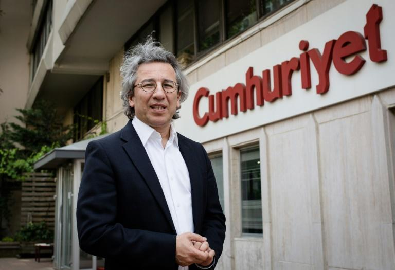 Cumhuriyet editor-in-chief Can Dundar poses outside the newspaper headquarters in Istanbul on June 3, 2015
