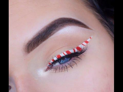 """<p>This sweet eye makeup tutorial uses less shadow and more liner to achieve a candyland accent for Christmastime.</p><p><a class=""""link rapid-noclick-resp"""" href=""""https://www.amazon.com/stila-Waterproof-Liquid-Eyeliner-White/dp/B007ZUGLZQ/?tag=syn-yahoo-20&ascsubtag=%5Bartid%7C10050.g.34534998%5Bsrc%7Cyahoo-us"""" rel=""""nofollow noopener"""" target=""""_blank"""" data-ylk=""""slk:SHOP WHITE LIQUID EYELINER"""">SHOP WHITE LIQUID EYELINER</a></p><p><a href=""""https://www.youtube.com/watch?v=giJT0PUcibo"""" rel=""""nofollow noopener"""" target=""""_blank"""" data-ylk=""""slk:See the original post on Youtube"""" class=""""link rapid-noclick-resp"""">See the original post on Youtube</a></p>"""