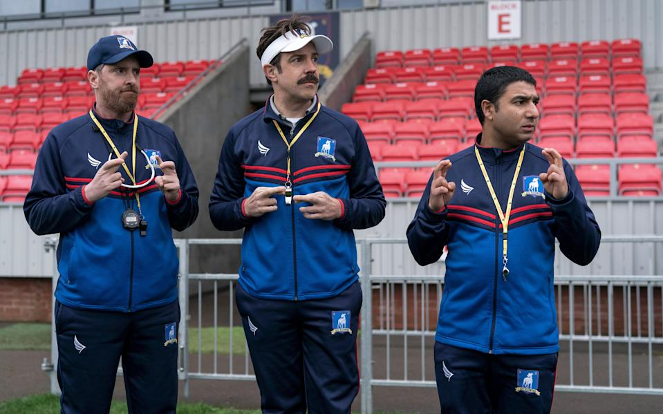 """Brendan Hunt as Coach Beard, Jason Sudeikis as Ted Lasso and Nick Mohammed as Nate Shelley in """"Ted Lasso"""" Season 2."""