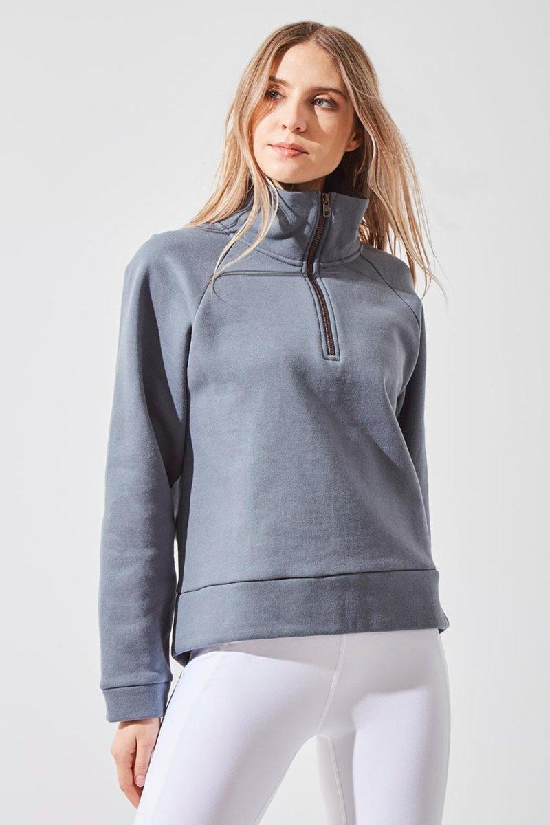 Beckon 1/4 Zip Cropped Sweatshirt. Image via MPG Sport.