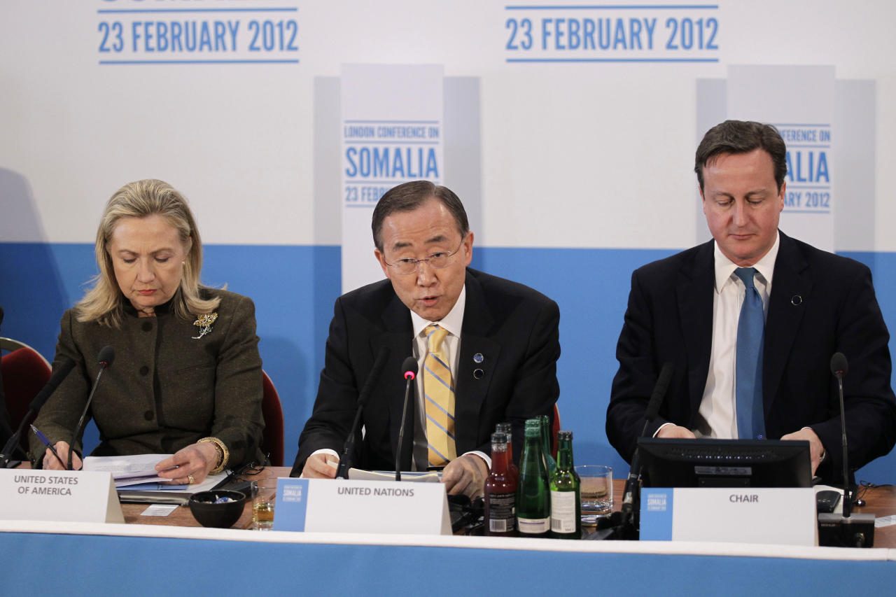 "UN Secretary-Genaral Ban Ki-Moon, center, talks as British Prime Minister David Cameron, right, and US Secretary of State Hilary Clinton listen on during the Somalia Conference at Lancaster House in London, Thursday, Feb. 23, 2012. Cameron told Somalia's fragile leadership, its neighbors and allies Thursday that the world would ""pay a price"" if it fails to help the troubled east African nation tackle terrorism, piracy and hunger. (AP Photo/Matt Dunham, Pool)"