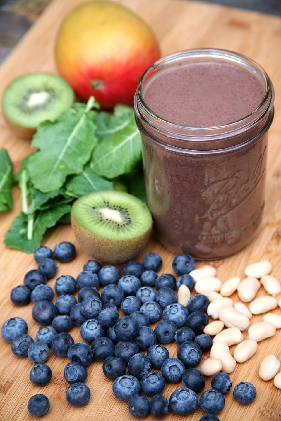 """<p><a href=""""https://www.popsugar.com/fitness/Why-You-Should-Add-Beans-Smoothies-42689481"""" class=""""link rapid-noclick-resp"""" rel=""""nofollow noopener"""" target=""""_blank"""" data-ylk=""""slk:Adding beans to your smoothie"""">Adding beans to your smoothie</a> seems like a weird idea, but just like tofu, they add a creamy consistency without any flavor. But Leslie said what's really important are the added fiber and protein they offer to keep you full and satisfied all morning long. </p> <p>Give this <a href=""""https://www.popsugar.com/fitness/Smoothie-Recipe-Healthier-Hair-30557044"""" class=""""link rapid-noclick-resp"""" rel=""""nofollow noopener"""" target=""""_blank"""" data-ylk=""""slk:blueberry mango kiwi kale smoothie"""">blueberry mango kiwi kale smoothie</a> a try, and you'll wonder why you didn't start adding beans to your blender sooner.</p>"""