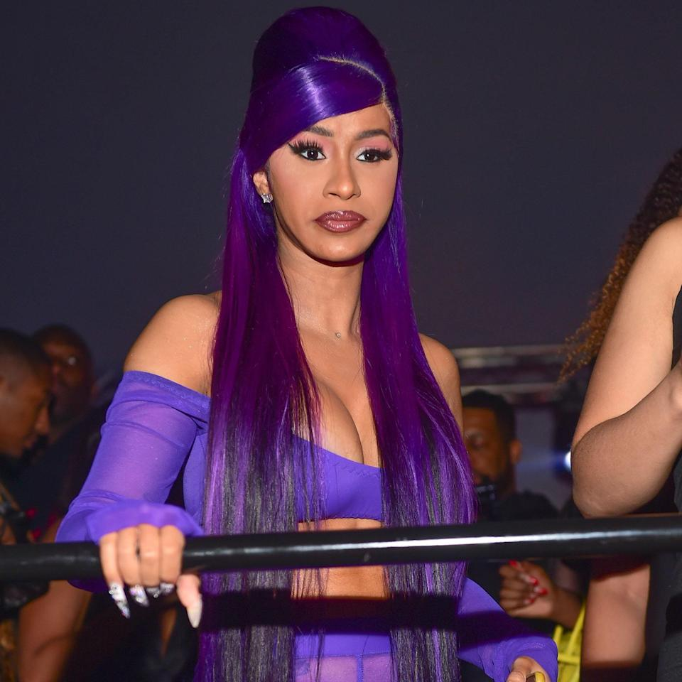 We love the monochromatic look Cardi wore while out at a night club in February 2020. The bold, eggplant-colored hair was styled into a sky-high beehive with the rest of the hair cascading past her waist. We have a good feeling that Snooki would approve of this massive poof.