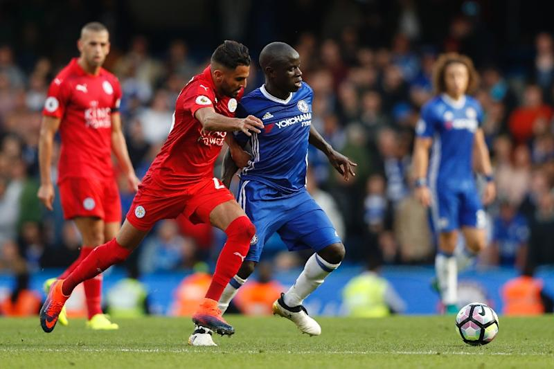 N'Golo Kante (centre right) challenges Riyad Mahrez (centre left) in Chelsea's game against Leicester City at Stamford Bridge (AFP Photo/Adrian Dennis)