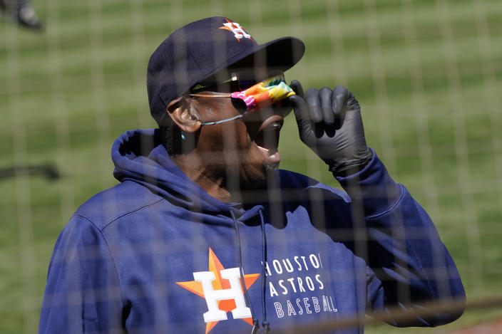 Houston Astros manager Dusty Baker Jr. lifts his face mask as he looks toward fans during the seventh inning of the team's baseball game against the Oakland Athletics in Oakland, Calif., Thursday, May 20, 2021. (AP Photo/Jeff Chiu)