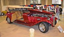 A 1932 Ford Phaeton, powered by a chromed Rolls-Royce Merlin V-12, owned by Timothy Tarris.
