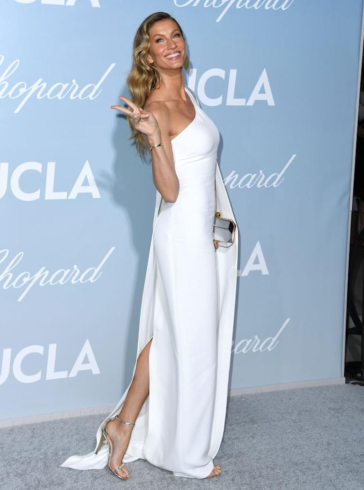<p>On February 21, model Gisele Bündchen wore a minimal Stella McCartney dress for the Hollywood for Science Gala. <em>[Photo: Getty]</em> </p>