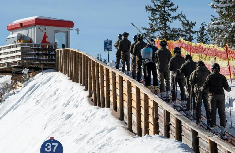 Austrian soldiers arrive to prepare the Streif slope ahead of this week's Hahnenkamm races