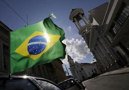 A Brazilian flag is seen over a car before the opening match between Brazil and Croatia at the 2014 World Cup, in Curitiba