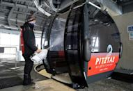 Gondola cabins get disinfected to reduce the spread of the coronavirus