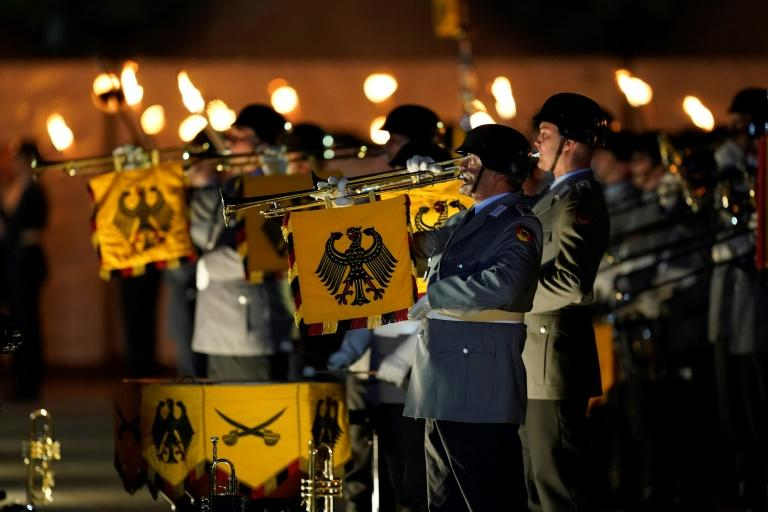 The power ballad was performed by a military brass band during the ceremony in Berlin