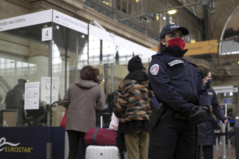 A police officer stands on the boarding platform for Britain after Brexit, Friday Jan.1, 2021 at the Gare du Nord railway station, in Paris. Britain left the European bloc's vast single market for people, goods and services at 11 p.m. London time, midnight in Brussels, completing the biggest single economic change the country has experienced since World War II. (AP Photo/Thibault Camus)