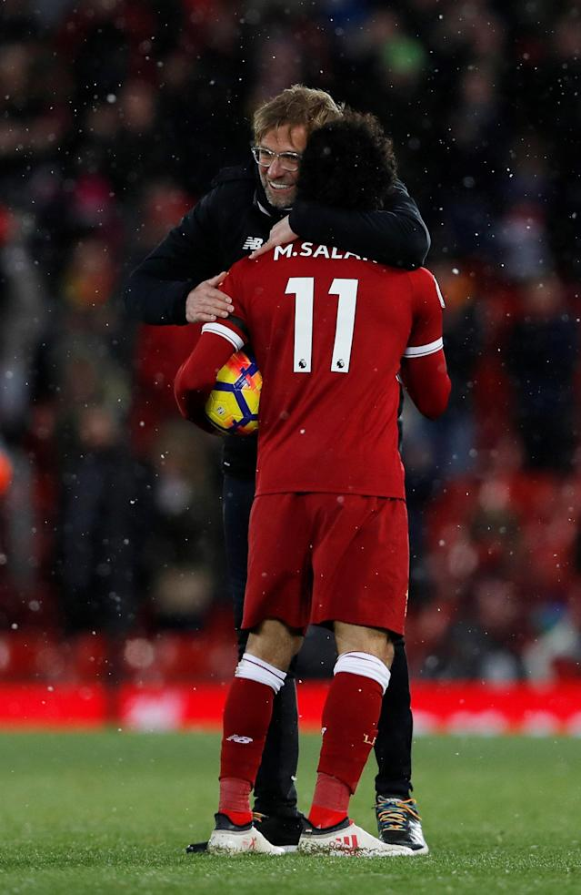 "Soccer Football - Premier League - Liverpool vs Watford - Anfield, Liverpool, Britain - March 17, 2018 Liverpool's Mohamed Salah celebrates with manager Juergen Klopp and the match ball after the match Action Images via Reuters/Lee Smith EDITORIAL USE ONLY. No use with unauthorized audio, video, data, fixture lists, club/league logos or ""live"" services. Online in-match use limited to 75 images, no video emulation. No use in betting, games or single club/league/player publications. Please contact your account representative for further details."