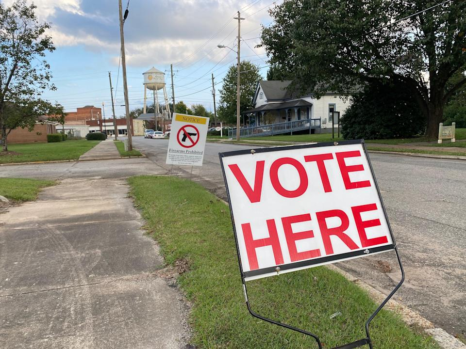 A sign outside a polling station in Fort Valley, Georgia, informs visitors that firearms are prohibited inside. (Richard Hall / The Independent )