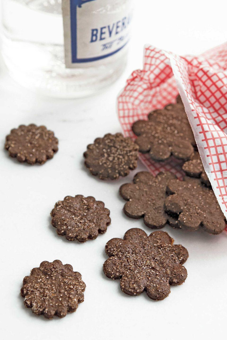 """<p>Semisweet chocolate chips, light-brown sugar, and Dutch-processed cocoa powder yield a refined richness.</p><p><strong><a href=""""https://www.countryliving.com/food-drinks/recipes/a4007/chocolate-coins-recipe-clx1211/?click=recipe_sr"""" rel=""""nofollow noopener"""" target=""""_blank"""" data-ylk=""""slk:Get the recipe"""" class=""""link rapid-noclick-resp"""">Get the recipe</a>.</strong></p>"""