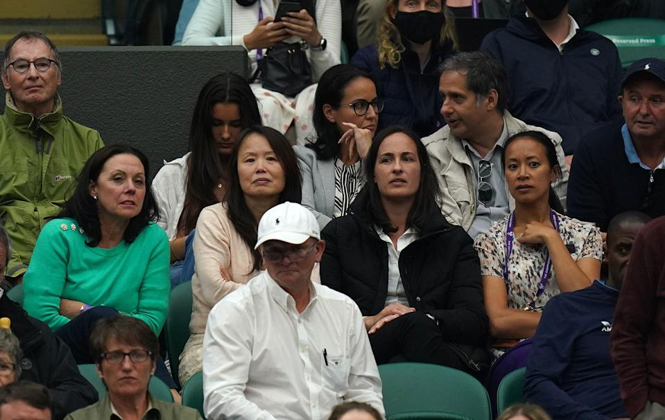 Renee Raducanu (second left) and Anne Keothavong (right) in the stands watching Emma Raducanu against Ajla Tomljanovic (PA)