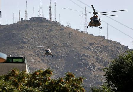 FILE PHOTO: Afghan Air forces helicopters fly over the site of a suicide attack followed by a clash between Afghan forces and insurgents during an attack on Iraq embassy in Kabul, Afghanistan, July 31, 2017. REUTERS/Omar Sobhani/File Photo