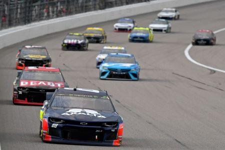 May 11, 2019; Kansas City, KS, USA; NASCAR Cup Series driver Alex Bowman (88) leads a pack of cars during the Digital Ally 400 at Kansas Speedway. Mandatory Credit: Jasen Vinlove-USA TODAY Sports