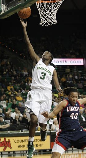 Baylor's Jordan Madden (3) shoots against Liberty's Devon Brown (40) during the first half of an NCAA college basketball game Friday, Nov. 23, 2012, in Waco, Texas. (AP Photo/LM Otero)