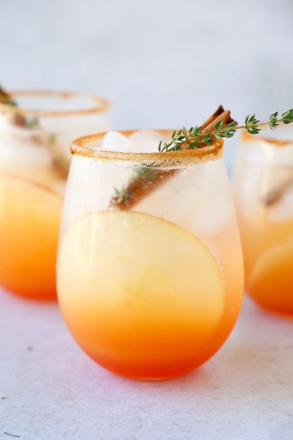 """<p>Enjoy your beloved Aperol spritz beyond summertime with this fall version. It calls for apple cider and a cinnamon sugar rim.</p><p><strong>Get the recipe at <a href=""""https://joyoliver.com/apple-cider-aperol-spritz/"""" rel=""""nofollow noopener"""" target=""""_blank"""" data-ylk=""""slk:Joy + Oliver"""" class=""""link rapid-noclick-resp"""">Joy + Oliver</a>.</strong></p><p><a class=""""link rapid-noclick-resp"""" href=""""https://go.redirectingat.com?id=74968X1596630&url=https%3A%2F%2Fwww.walmart.com%2Fsearch%2F%3Fquery%3Dstemless%2Bwine%2Bglass&sref=https%3A%2F%2Fwww.thepioneerwoman.com%2Ffood-cooking%2Fmeals-menus%2Fg33510531%2Ffall-cocktail-recipes%2F"""" rel=""""nofollow noopener"""" target=""""_blank"""" data-ylk=""""slk:SHOP STEMLESS WINE GLASSES"""">SHOP STEMLESS WINE GLASSES</a></p>"""