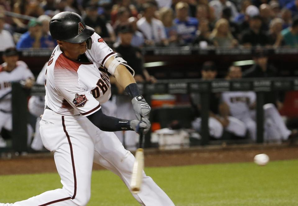 Arizona Diamondbacks' Nick Ahmed connects for an RBI single against the Chicago Cubs during the sixth inning of a baseball game Wednesday, Sept. 19, 2018, in Phoenix. (AP Photo/Ross D. Franklin)