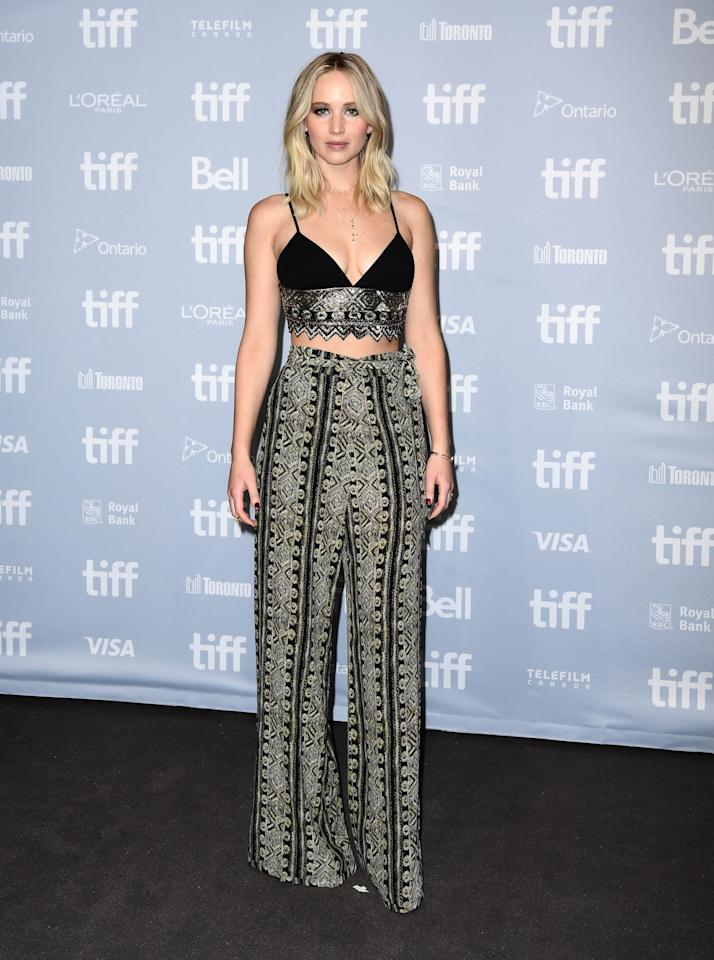 <p>A boho look was seen on J Law during the day in Toronto. Wearing a matching bralette and flared trousers by Sally LaPointe, the actress proved she can do casual.<br /><i>[Photo: Getty]</i> </p>