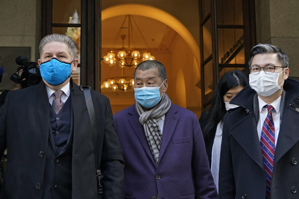 Hong Kong pro-democracy activist and media tycoon Jimmy Lai, center, leaves the Court of Final Appeal during a break in Hong Kong, Thursday, Dec. 31, 2020. Lai appeared in court Thursday as prosecutors asked the city's top judges to send him back to detention after he was granted bail last week on fraud and national security-related charges. (AP Photo/Kin Cheung)