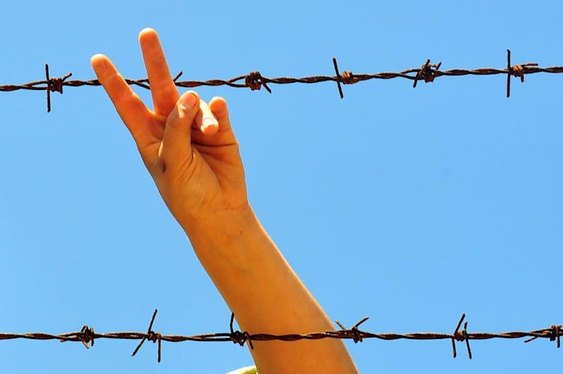 """Flashing the """"peace"""" sign in photos could lead to fingerprint data being stolen, Japanese researchers said"""